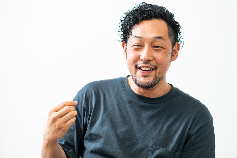 代表の荒川健司さん。趣味でボードゲームをつくっている